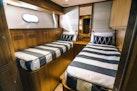 Johnson-Flybridge w/Hydraulic Platform 2022-JOHNSON 83 FLYBRIDGE Taiwan-Port Side Midship Cabin-1059272 | Thumbnail