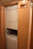 Bertram-60 Convertible 1998-CHARDAN Lighthouse Point-Florida-United States-Stacked Washer/Dryer in Hallway Between Staterooms-1122715 | Thumbnail