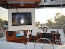 Hatteras-Cockpit Motoryacht 1989-Amelia Boca Raton-Florida-United States-Upper Helm With TV Cabinet Open-1206104 | Thumbnail