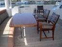 West Bay-Custom Enclosed Bridge 2005-Dream Weaver North Palm Beach-Florida-United States-Aft Deck Dining-1276219 | Thumbnail
