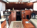 Hatteras-37 Convertible 1981-Reel Development Vero Beach-Florida-United States-Salon and Galley Looking Into Master V Berth-1347826 | Thumbnail