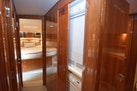 Riviera-Enclosed Flybridge 2007-Magica II Coral Gables-Florida-United States-Hallway Door Revealing Stackable Washer_dryer-1443180 | Thumbnail