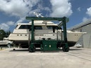 Hatteras-Euro Transom Motor Yacht 1989-Different Drummer II Stuart-Florida-United States-In Slings  Starboard-1486869 | Thumbnail