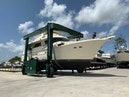 Hatteras-Euro Transom Motor Yacht 1989-Different Drummer II Stuart-Florida-United States-In Slings  Stbd Bow-1486870 | Thumbnail