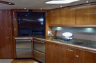 Sunseeker-Predator 2003-Low Profile PALM BEACH-Florida-United States-Galley With Flat Screen TV Open Doors-1576339 | Thumbnail