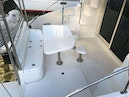Leopard-37 PC 2008-Even Keel Cocoa Beach-Florida-United States-Aft Deck Table With Bar Stools And Built In Seating And Storage-1546927 | Thumbnail