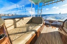 Winter Custom Yachts-46 Walkaround 2019-Family Circus Stuart-Florida-United States-Teak Starboard Seating with Diamond Stitched Ultra-Leather Upholstery and Storage Below-1563758 | Thumbnail