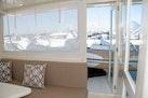 Hampton-60 Motor Yacht 2007-Family Biz Mount Pleasant-North Carolina-United States-Door to Aft Deck Davit & Dinghy-1600110 | Thumbnail