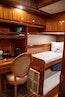 Hampton-60 Motor Yacht 2007-Family Biz Mount Pleasant-North Carolina-United States-Desk with burl wood top and bookshelves-1600084 | Thumbnail