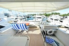 Horizon-65 Skylounge 2002-Alls Well Miami Beach-Florida-United States-Flybridge Deck Looking Aft with Custom Aft Seating, Table and Portside Lounge-1668781 | Thumbnail