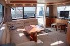 Bayliner-4788 Pilothouse 1998-J&B Mount Pleasant-South Carolina-United States-Large Fold-out, Adjustable Height Teak Table-1675772 | Thumbnail