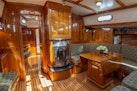 Hinckley-Custom 60 1997-Chimera Stuart-Florida-United States-Custom Dutch Built Stainless/Glass Fireplace with Granite Hearth-1680235 | Thumbnail