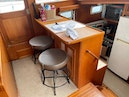 Offshore Yachts-48 Yachtfisher 1990-TIME LAPSE Wickford-Rhode Island-United States-Breakfast Bar Port Forward-1750288 | Thumbnail