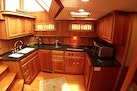 Legacy Yachts-Flybridge Sedan 2004-ARABELLA Stuart-Florida-United States-Well-appointed Galley with black granite counter-453039 | Thumbnail