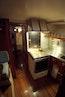 Trumpy-CPMY 1960-ATLAS Stuart-Florida-United States-Passageway through Galley to Crew Quarters-452890 | Thumbnail